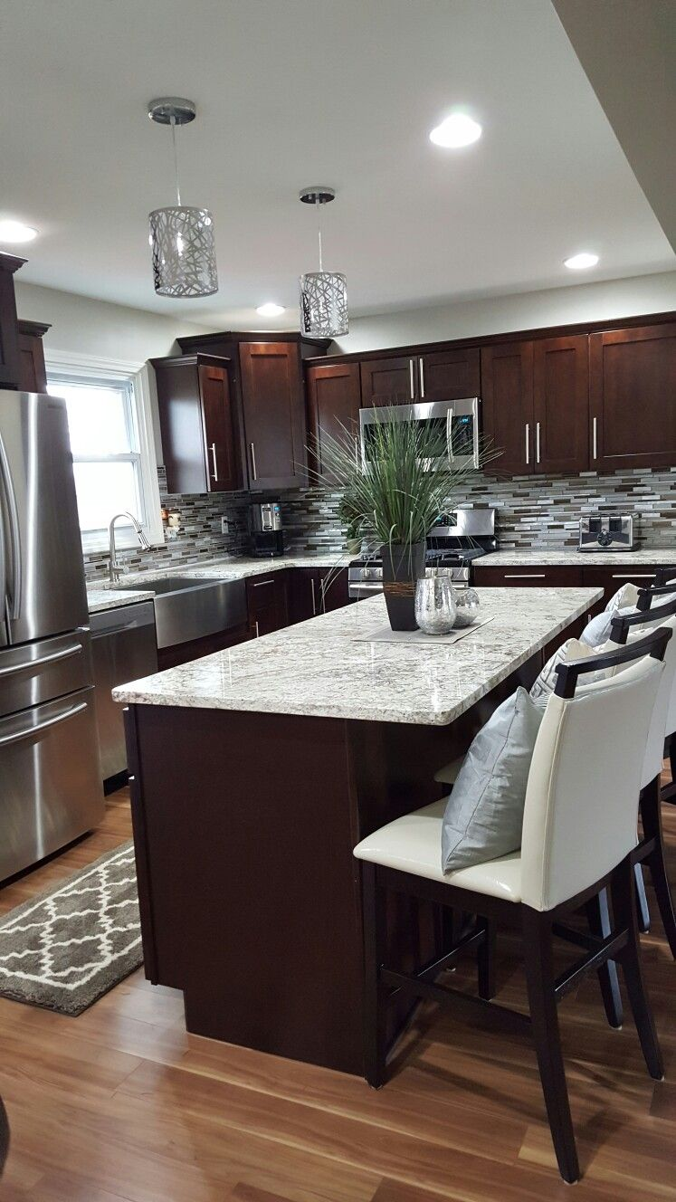 Finished kitchen river run shaker cabinets with snow white granite