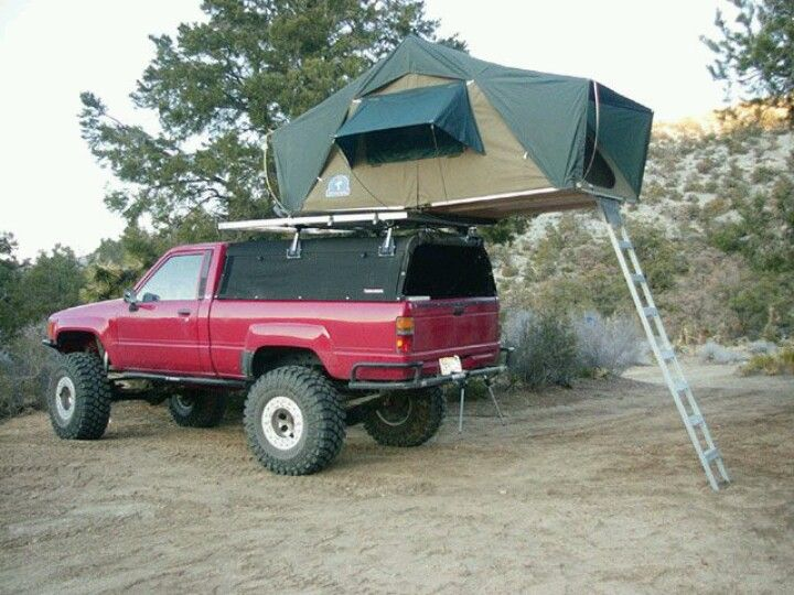 First Gen Doing Some Camping In Style Toyota Trucks Toyota Trucks 4x4 Motorcycle Camping Gear