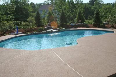 grey, smooth concrete pool decks new england hardscapes inc acton