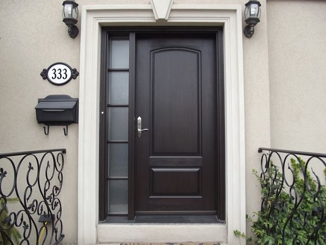 front door with one sidelightEntry door with one simply designed sidelight Love the wrought