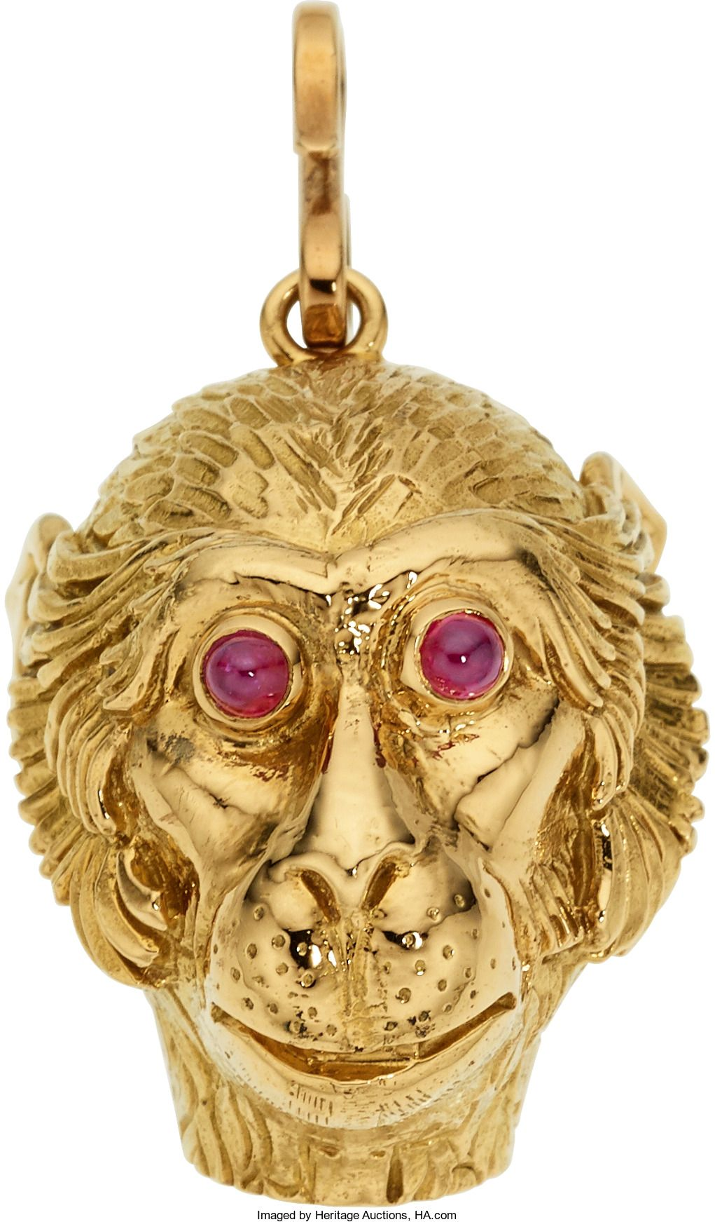 The monkey zipper pull features ruby cabochons, set in 18k gold, marked Webb. Gross weight 30.20 grams. Dimensions: 1-5/8 inches x 7/8 inch Estimate: $4,000 - $6,000.