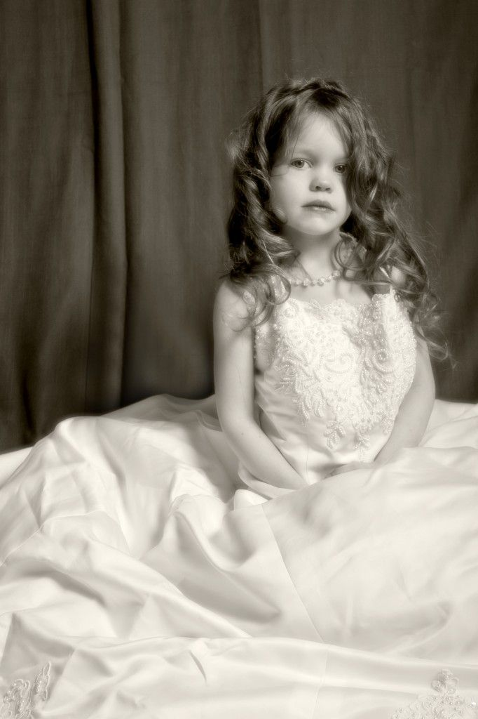photo of a little girl wearing her mother\'s wedding dress to show ...
