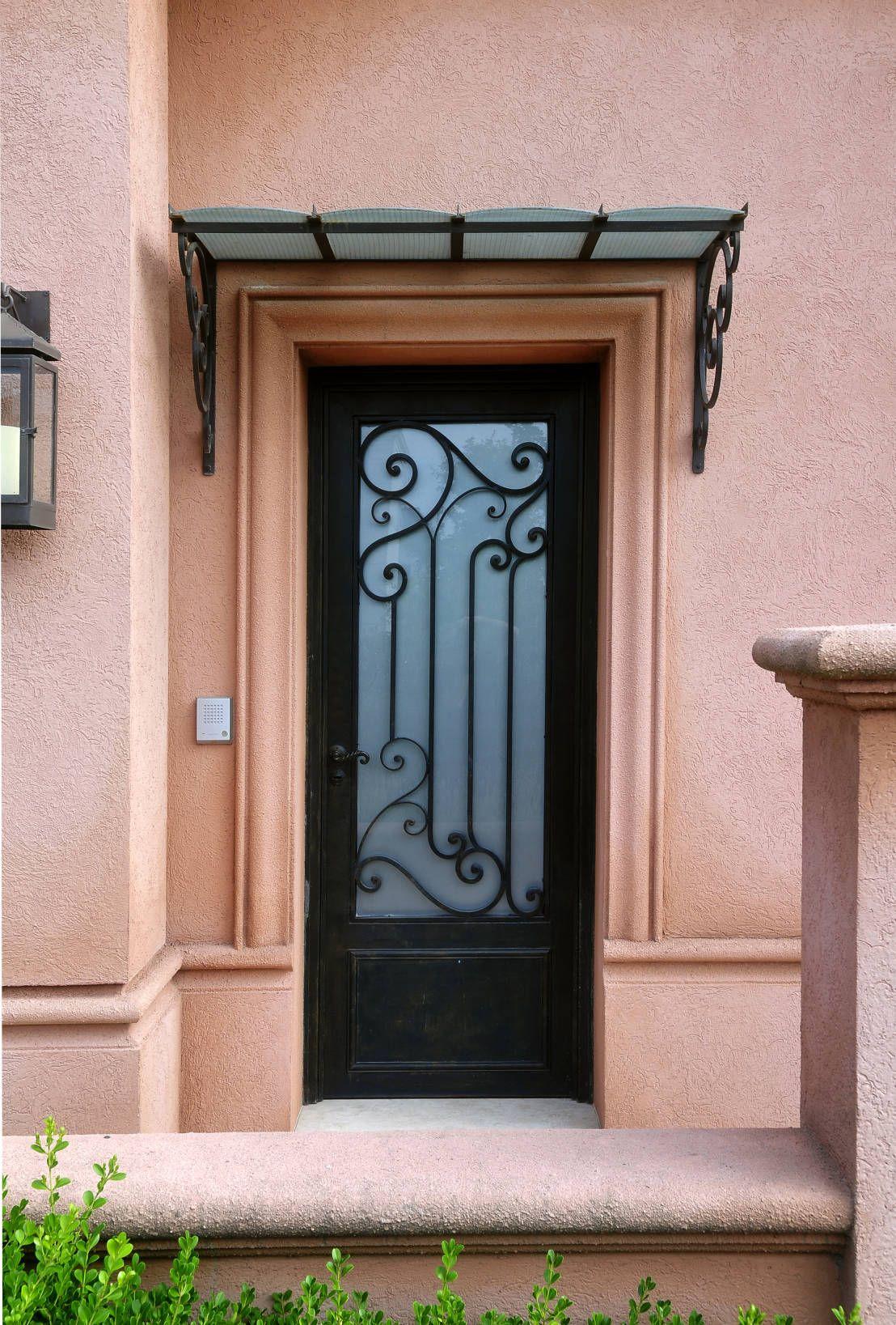 Alero y puerta de hierro forjado de del hierro design portal Puertas hierro forjado