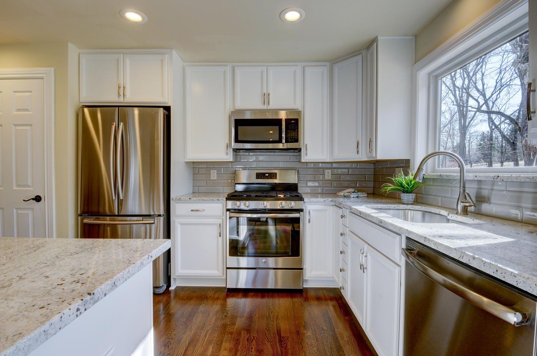 white kitchen cabinets  open concept floor plans kitchen