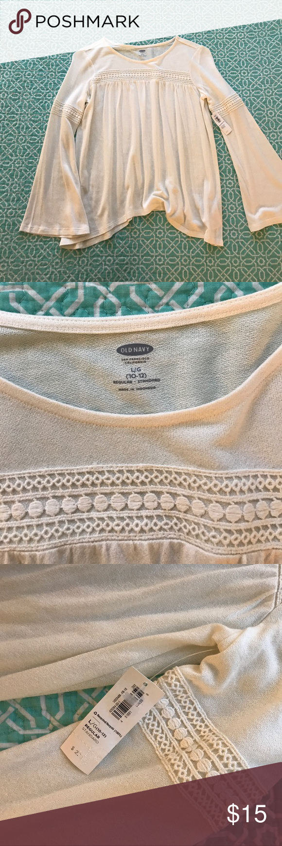 Float bell sleeve shirt with crochet detail Old navy bell sleeve top with crochet around the sleeves and across the top. Brand new with tag. Children's size L would fit XS or S adult. Old Navy Tops Blouses