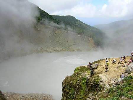A world heritage site, the Boiling Lake in the Morne Trois Pitons National Park, Dominica, is actually a flooded fumarole. It is filled with bubbling blue-grey water and surrounded by a vapor cloud.