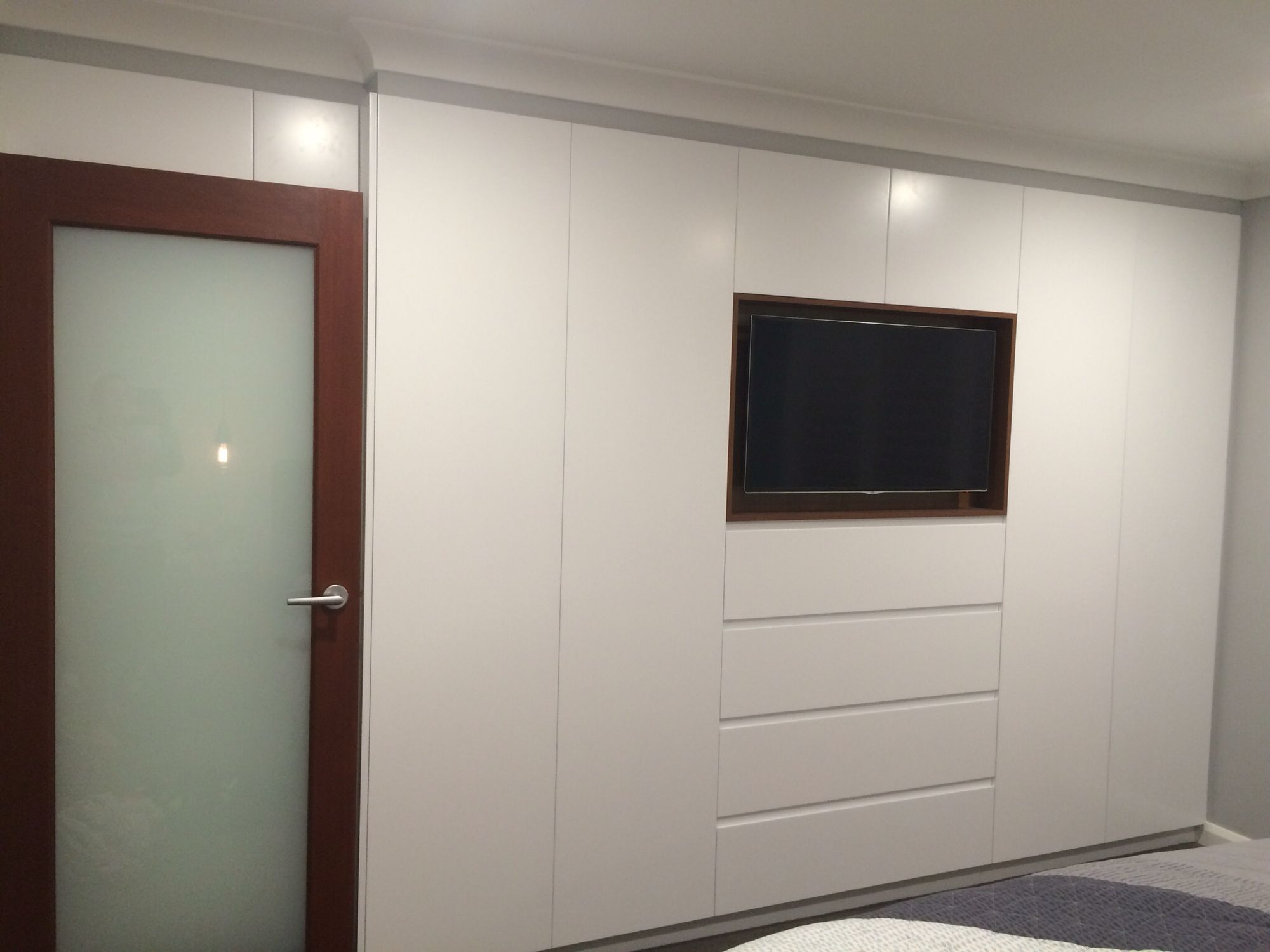 Bedroom with tv and closet - White Built In Wardrobe With Walnut Timer Inset For Tv