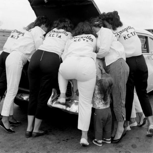 The Dragettes, an all girl hot rod club, 1959. Love the little girl reaching for the fender.
