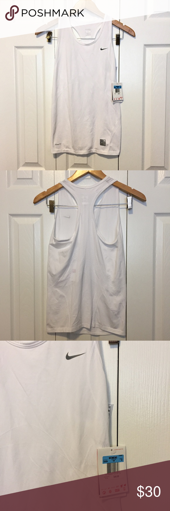 "Nike FitDry White Workout Tank NWT Nike FitDry Workout/Compression Training Tank. Perfect workout top for any activity. Sweat-wicking capabilities. Fits true to size with stretch. Appx: 32"" bust, 25.5"" length. NWT-never worn, excellent condition. Nike Tops Tank Tops"