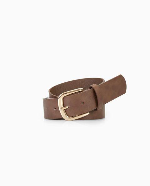 """<p>This basic jean belt features a vegan leather body with a shiny metal buckle.</p>    <ul>  <li>1.25"""" Width</li>  <li>Man Made Materials / Metal</li>  <li>Imported</li>  </ul>"""