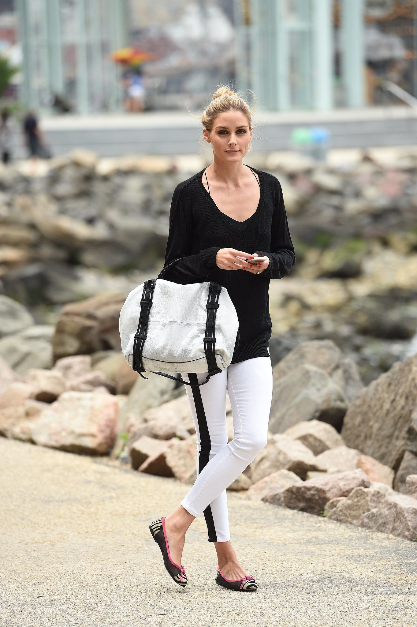 Olivia Palermo: With her cool black and white outfit, Olivia's black and silver two-toned She + Lo bag was the perfect complement. Shop it for yourself when you scroll.
