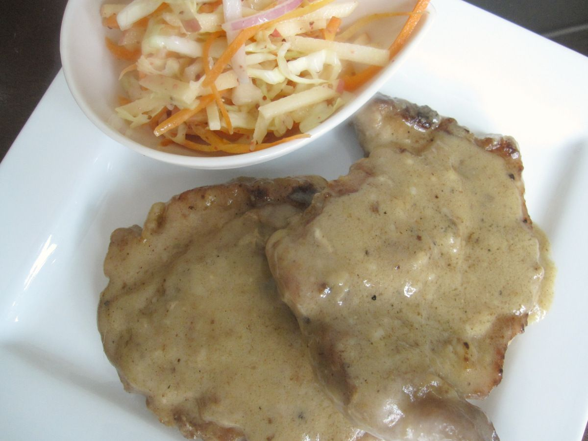 Smothered Pork Chops with Apple Coleslaw