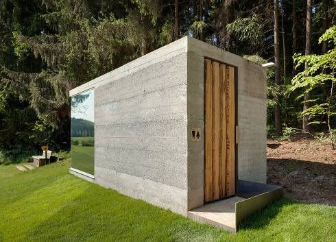 """A team effort to construct this micro-building that houses the toilets alongside the """"green"""" in Lauterhofen, Germany."""