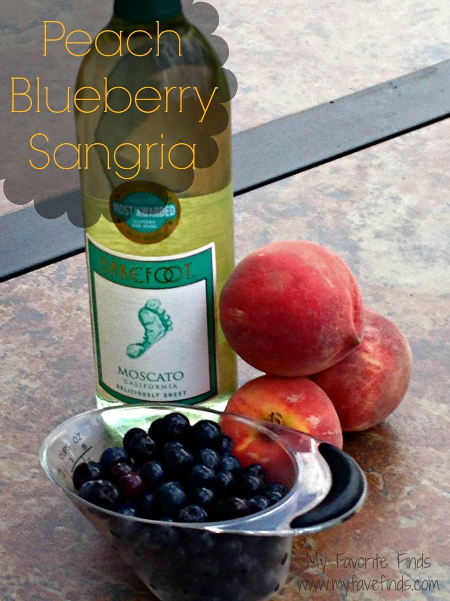 Peach Blueberry Sangria Peaches Blueberries And A Chilled Bottle Of Moscato Yum Blueberry Sangria Peach Blueberry Yummy Drinks