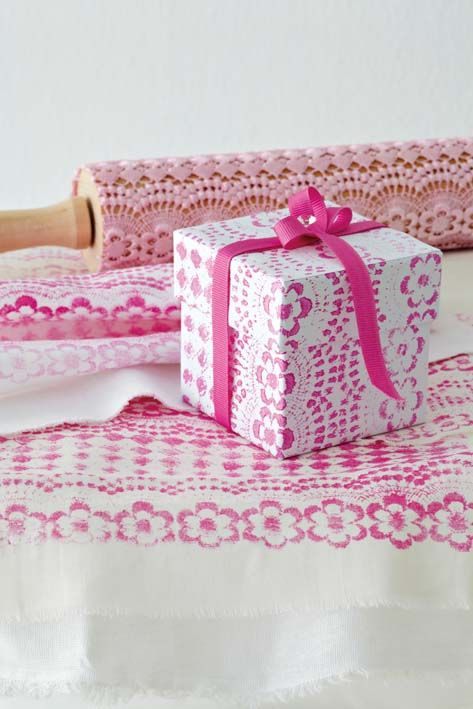 Print with lace. With this method you can cover everything from giftwrap to fabric and even a wall with a lace pattern.