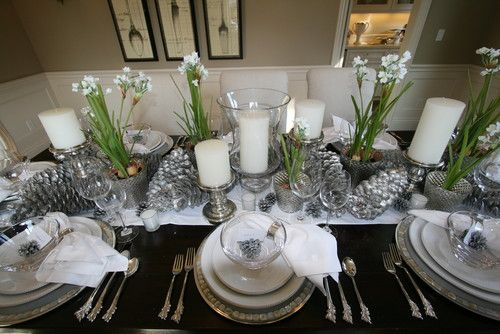 Instead of red, which is traditional for Christmastime table settings, mix things up a little with silver. Crocuses and pine cones were painted to create a monochromatic palette that's modern and elegant.