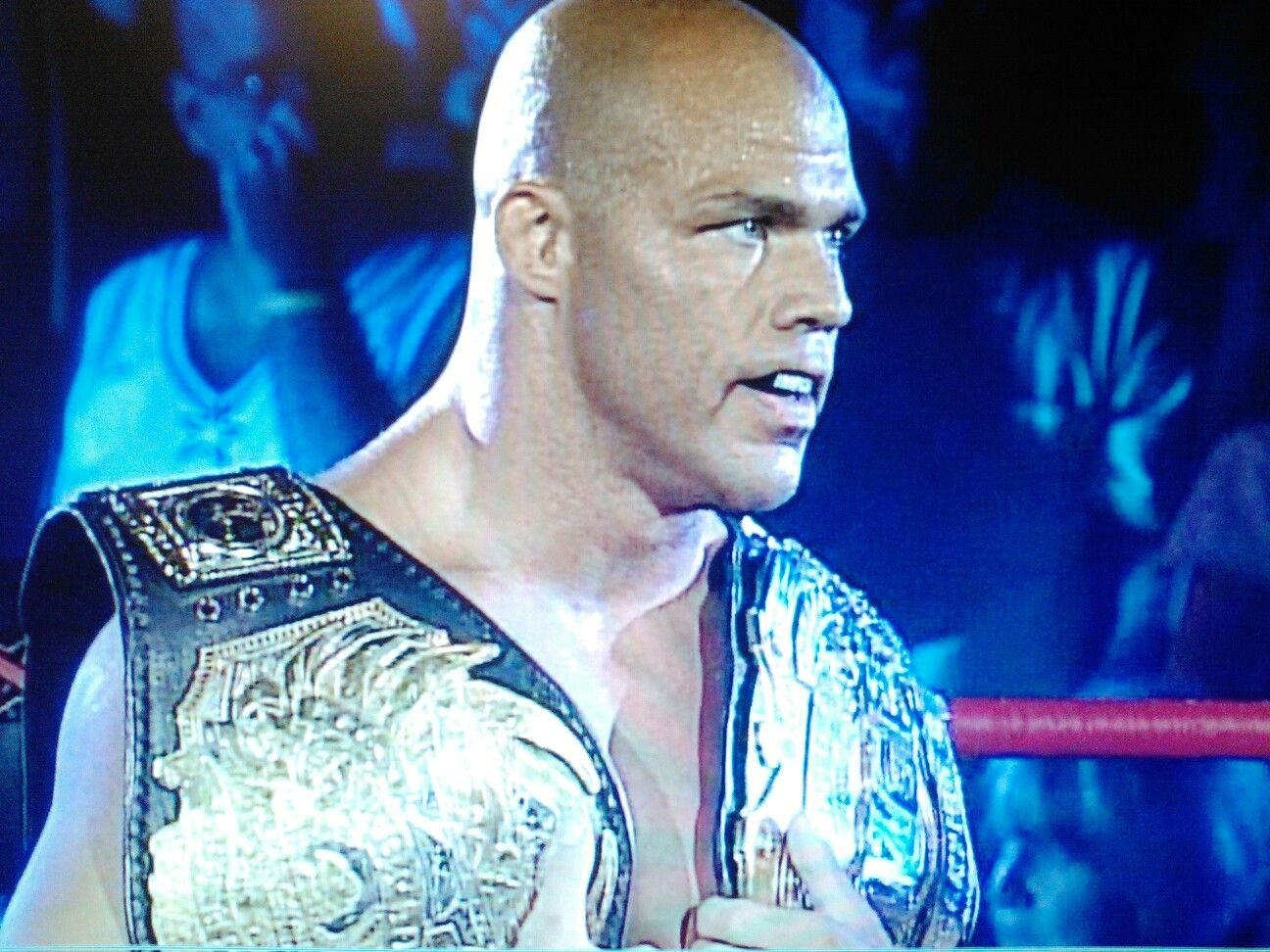 Kurt Angle with both his TNA World Championship and IWGP Heavyweight Championship titles.