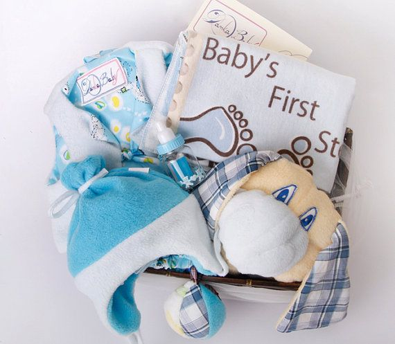 Newborn Gift Including: zoo blanket, double sided vest, matching pants, a hat with a three way dressing,  flannel diaper, rattle and a small bottle with psalms.