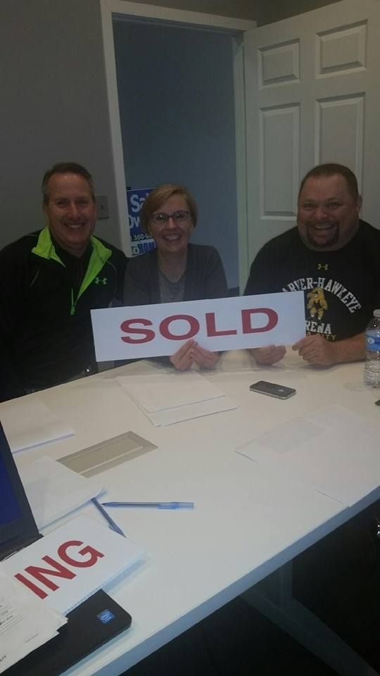 Buyer and Sellers meeting in the conference room to finalize the - home purchase agreement