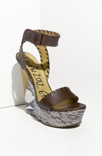 Free shipping and returns on Lanvin 'Puzzle' Platform Sandal at Nordstrom.com. Pieced python-embossed leather rounds the curvaceous wedge of a towering, whipstitched leather sandal.