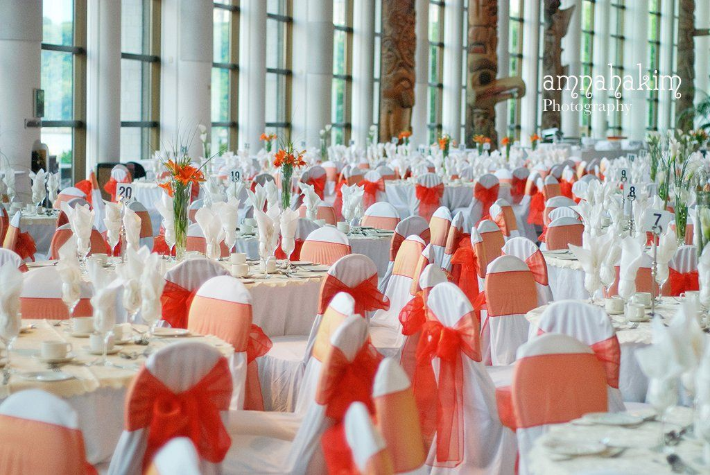 White slip on covers with Orange Organza Sashes at the
