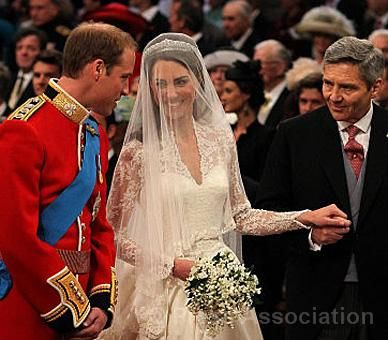 Catherine Middleton, with her father Michael Middleton, greet Prince William at the altar in Westminster Abbey, 29 April 2011