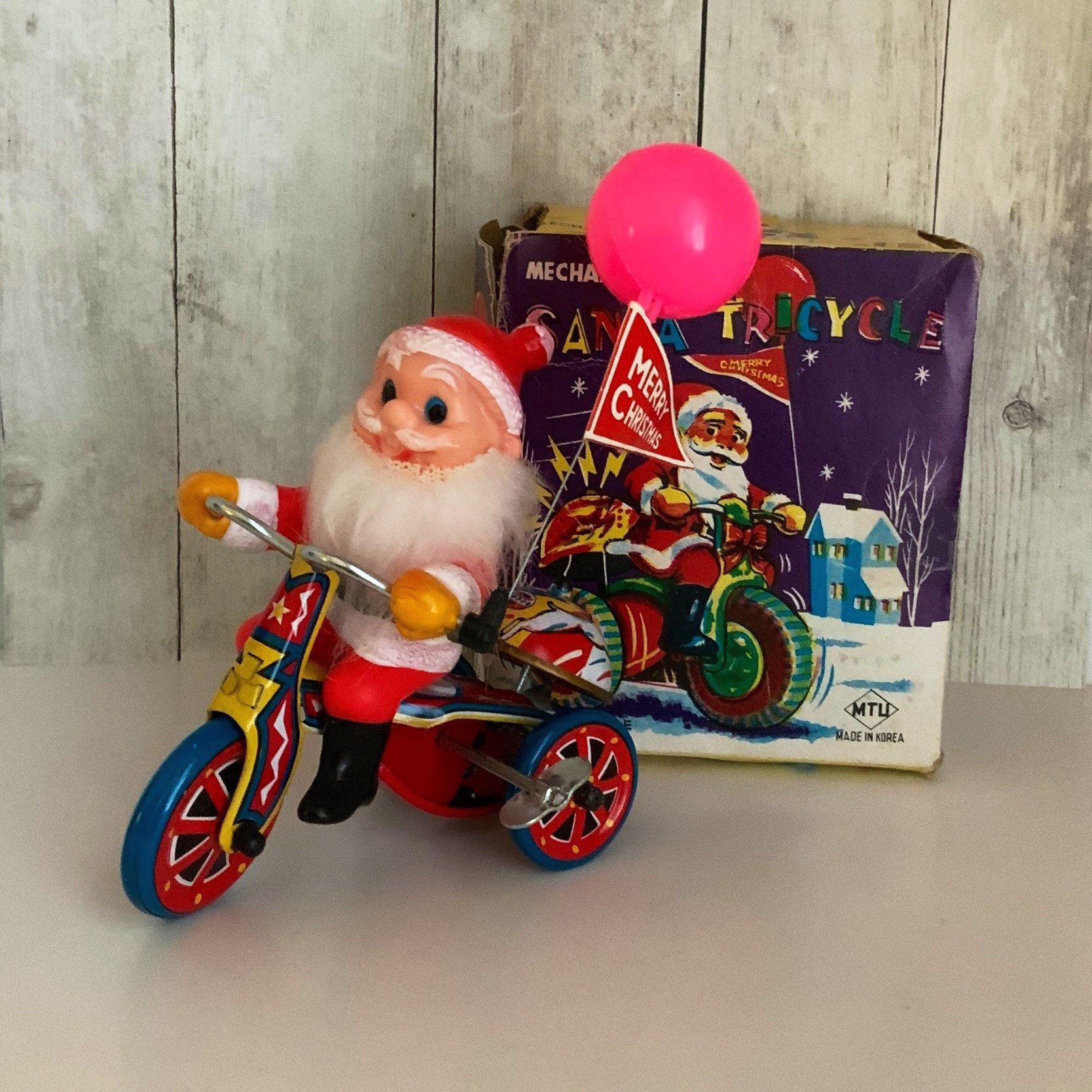 Vintage Tin Wind Up Santa Claus Riding Tricycle