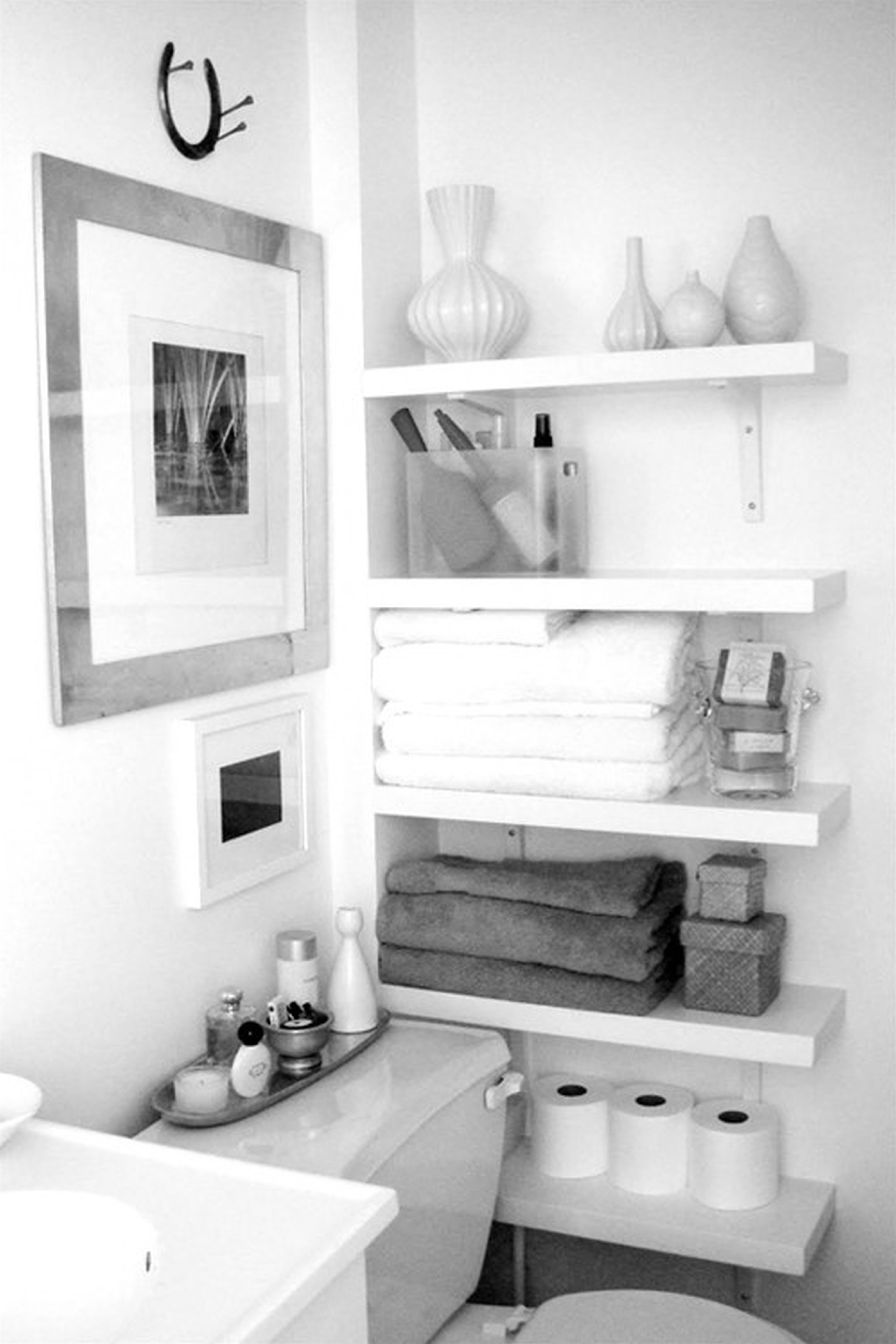 Awesome white hardwood floating shelves as corner bathroom