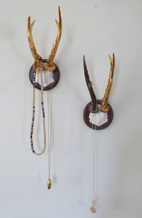 i love the look of these gold-painted antlers with carefully selected necklaces hanging to add further dimension.