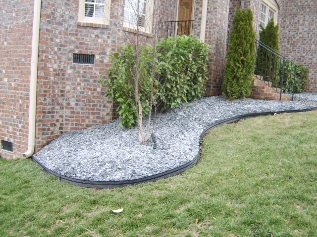 Cheap flower garden ideas stone or just a simple for Cheap easy landscape edging