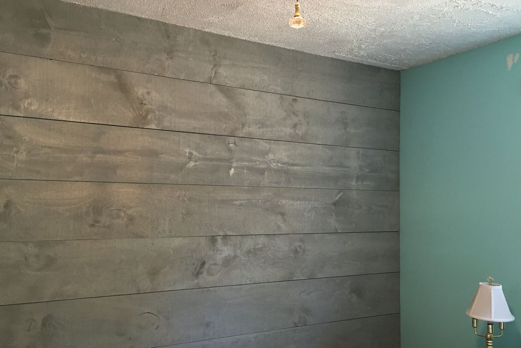 Shiplap wall stained in drift wood grey