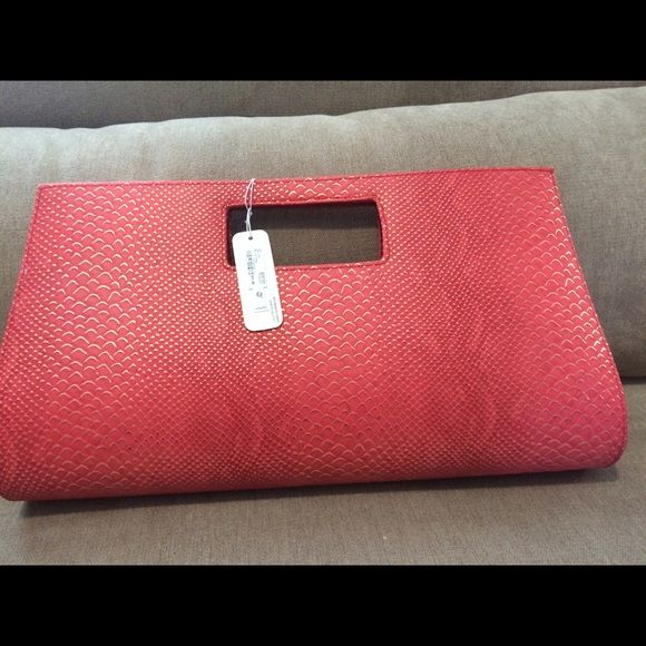 Pink snake skin clutch Snake skin clutch with gold trim.  Brand new. Super cute. Thanks for visiting my closet!! Charming Charlie Bags Clutches & Wristlets