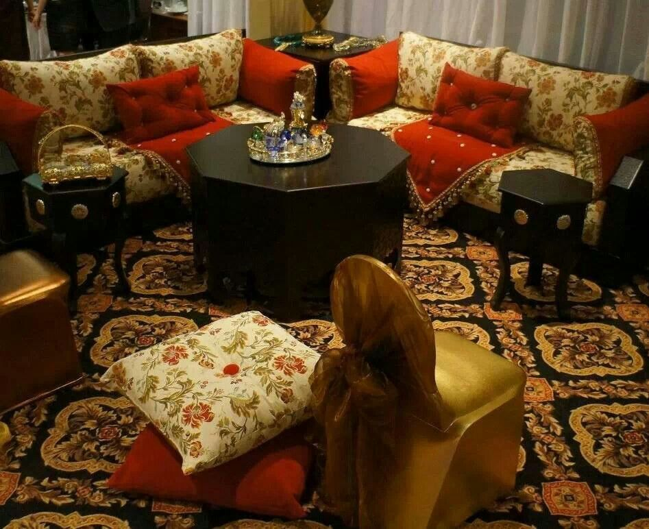 I love this. Small moroccan style den using red beige and floral with black furniture