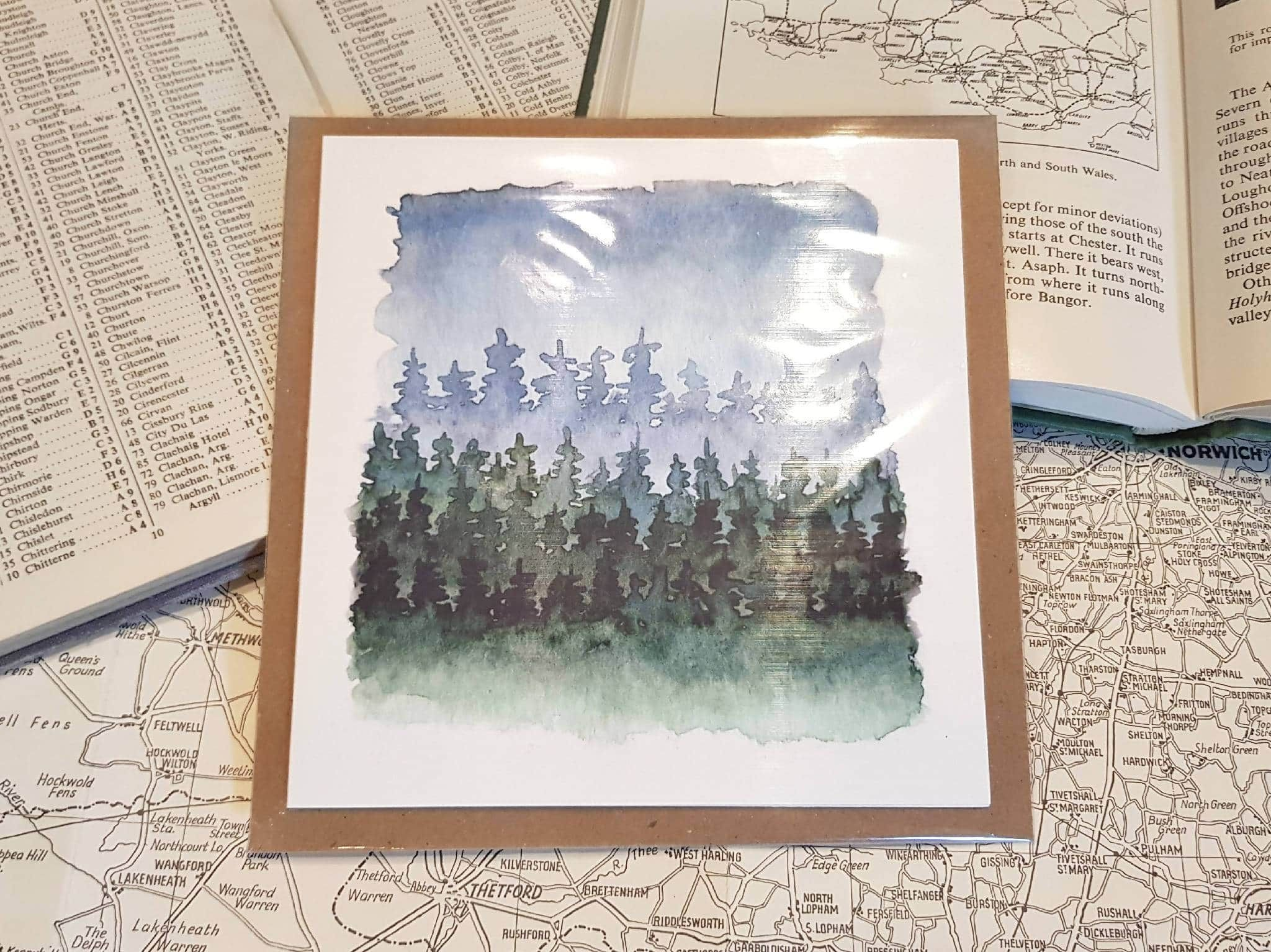 Greetings card of watercolour print of a winter forest