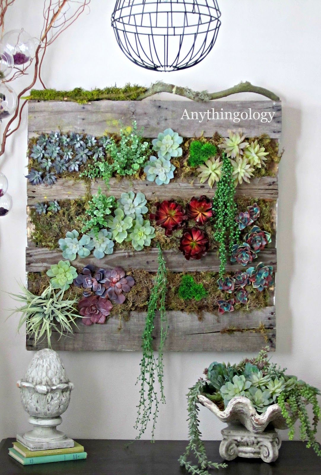 Anythingology.com great idea for indoor vertical succulent garden......using fake plants!  No water mess!