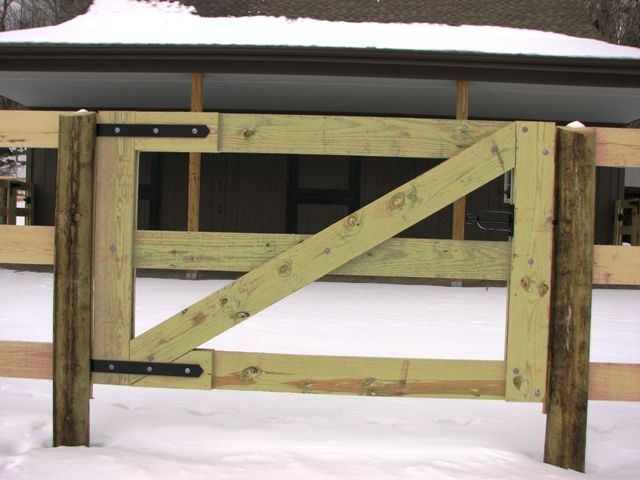 how to build a horse arena fence