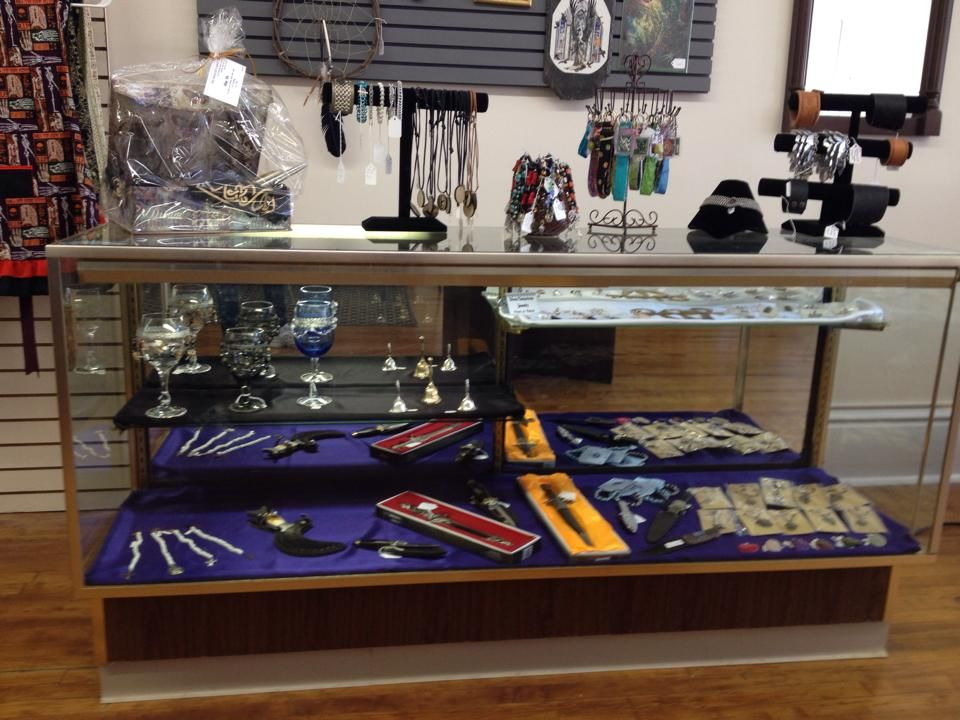 We have TWO glass cases, chock full of wands, athame's, jewelry and other miscellaneous goodies