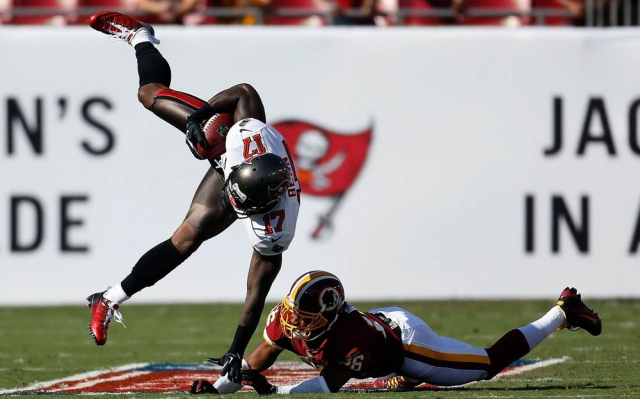 Defensive back Josh Wilson of the Washington Redskins hits receiver Arrelious Benn of the Tampa Bay Buccaneers.
