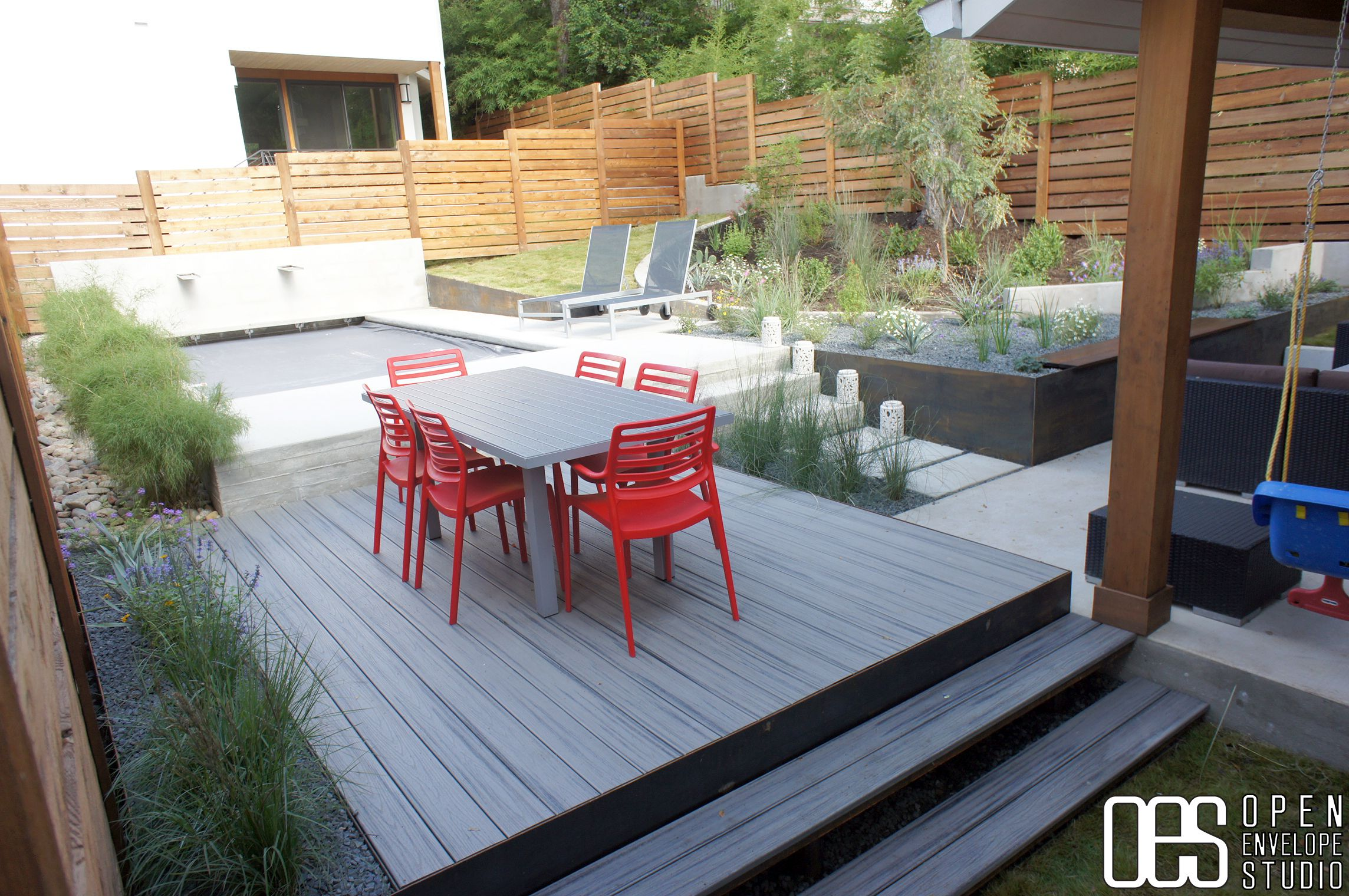 oes thomas residence trex deck in grey with poured concrete