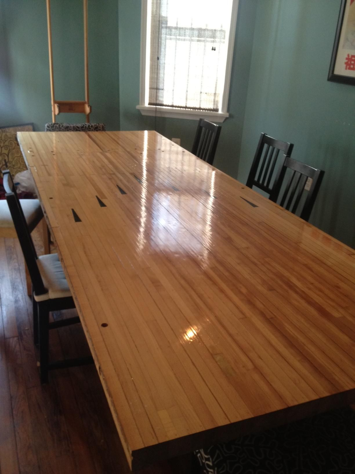 My Roommate Turned A Piece Of A Bowling Alley Into A Dining Room Table.