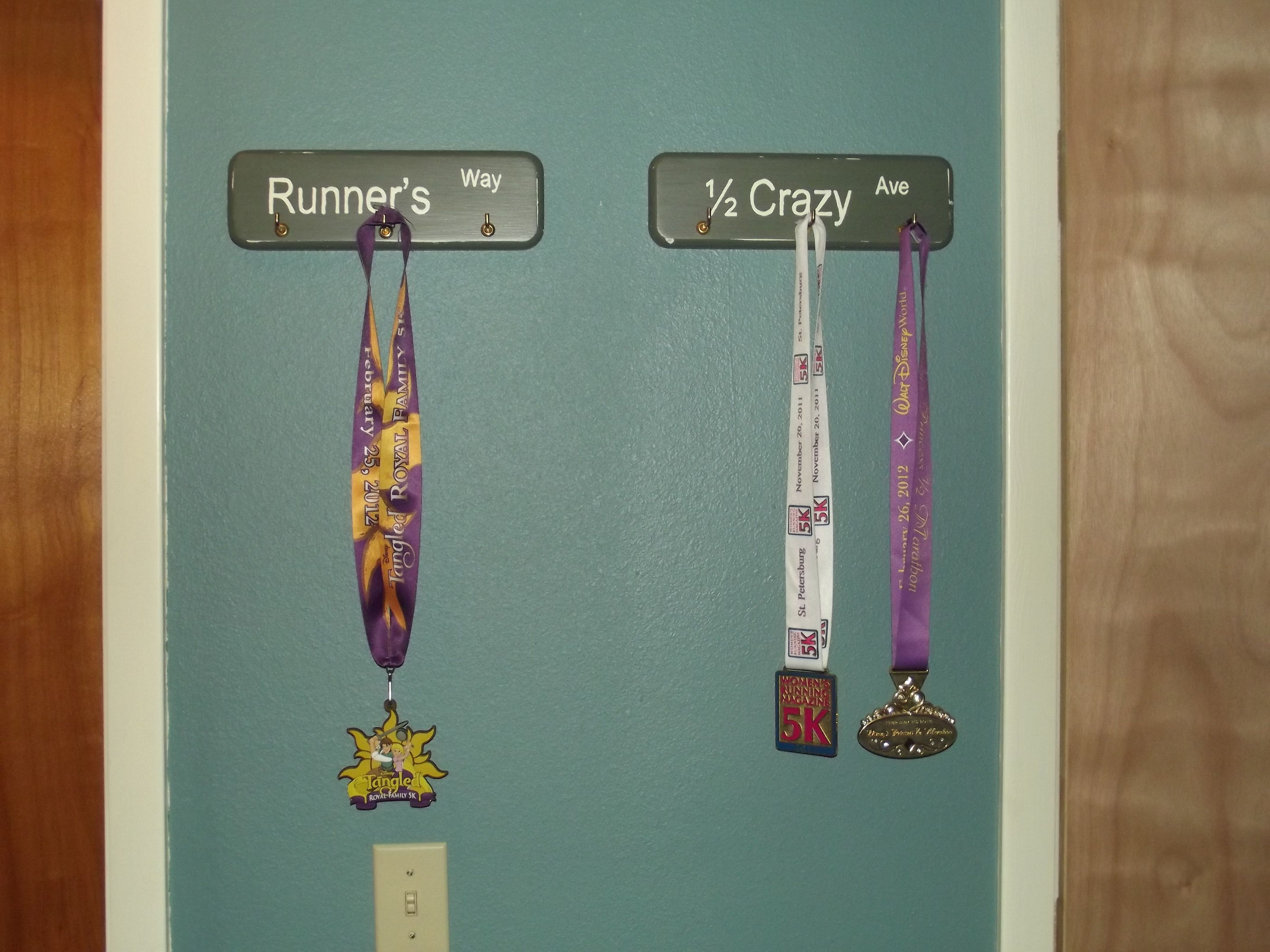 Race medal display up on the wall