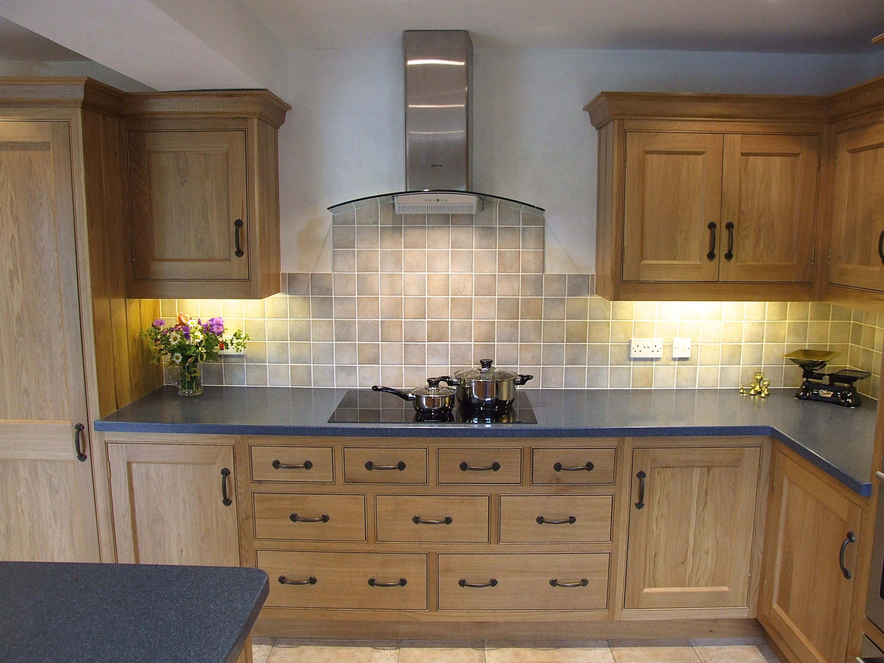 Traditional Oak Kitchen Happily Wears Black Wrought Iron Door Furniture,  With Blue Corian Worktops,