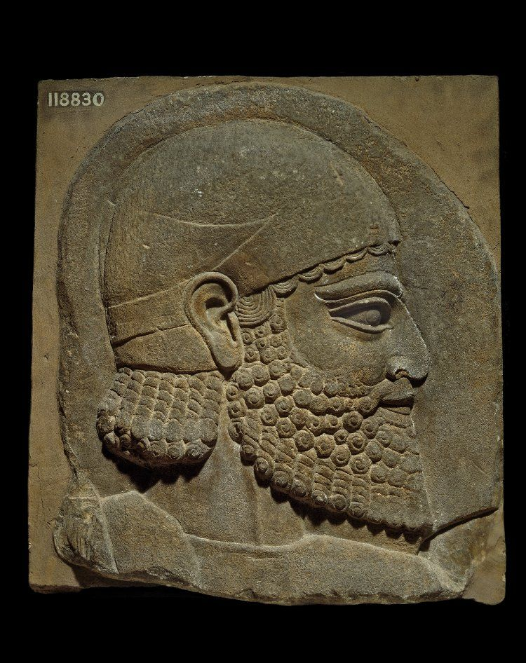 Gypsum wall-panel depicting a bearded man in relief: this bearded