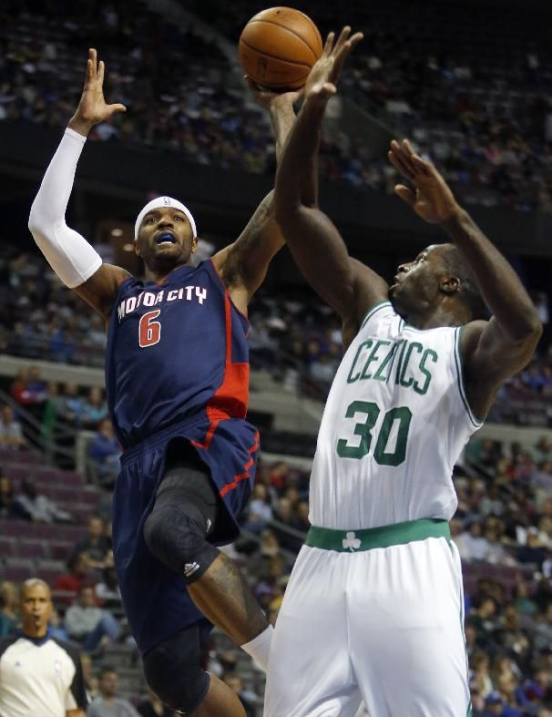 Detroit Pistons forward Josh Smith (6) takes a shot against Boston Celtics forward Brandon Bass (30) during the second half of an NBA basketball game Sunday, Nov. 3, 2013, in Auburn Hills, Mich. Smith scored 15 points and pulled down seven rebounds in a 87-77 win. (AP Photo/Duane Burleson)
