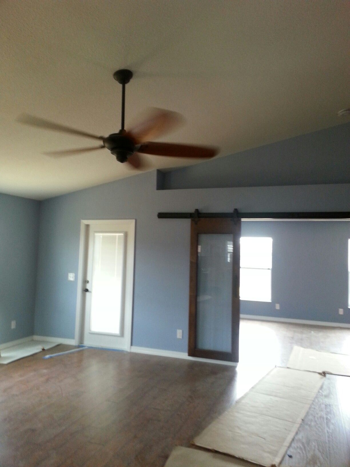 Living room. Wall color windy blue from Sherwin Williams