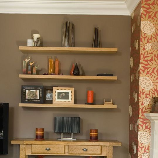 Try contrasting a bold wallpaper with a neutral wall paint - Feature wall ideas living room wallpaper ...