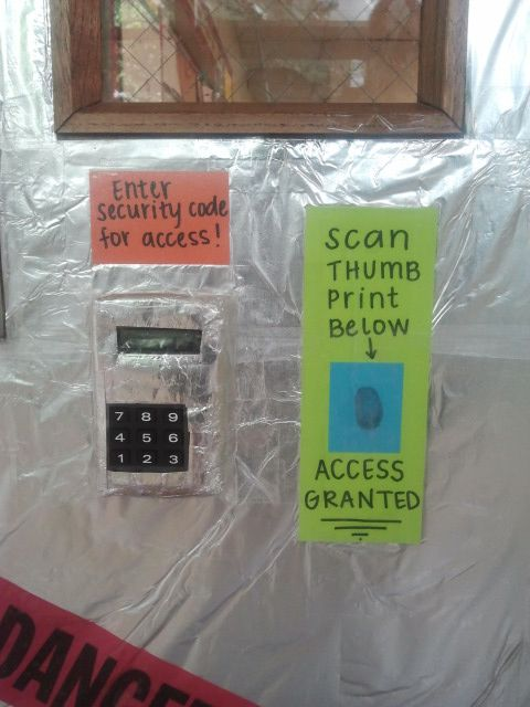 """Close up of door security - aka covered calculator passcode and thumbprint """"scanner"""" Awesome idea for front door with check-in"""