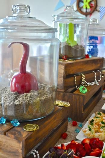 Pirate Party -- brown sugar as sand in large jars with ships, treasure or pirate's hook.