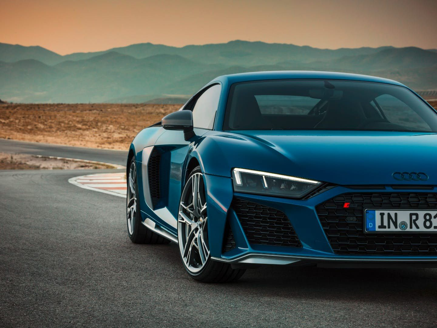 Audi Gives The R8 Coupe More Power And A Revised Look Audi R8 4 Door Sports Cars Super Cars