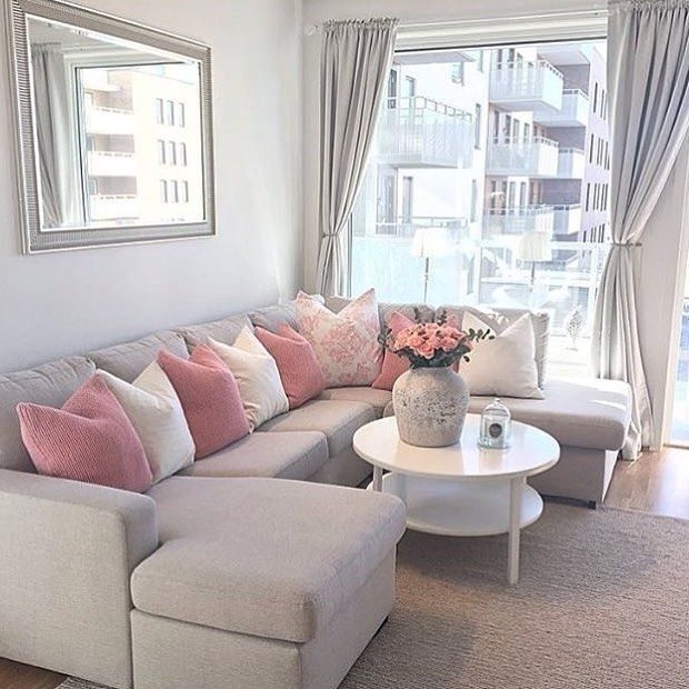 Love the couch style and pink color accents for the living room ...